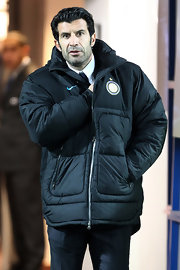 Luis cozied up in a black puffer jacket.