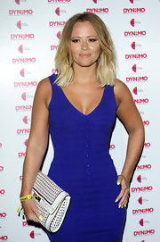 Kimberley Walsh accessorized with a stylish woven-leather clutch when she attended the launch of 'Magician Impossible.'