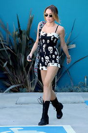 Miley Cyrus headed to Pilates class wearing a pair of clunky black lace-up boots.
