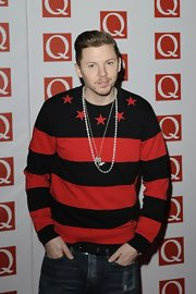 Professor Green looked striking at the Q Awards in a bold red and black striped crewneck sweater.