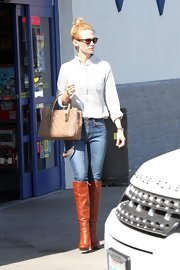 January Jones' tan leather knee-high boots were a polished finishing touch to her weekend look.