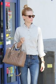 January Jones styled her sleek shirt and denim combo with a cute quilted chain strap tote.