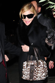 Madonna carried a leopard print tote while out with Tom Ford for dinner.