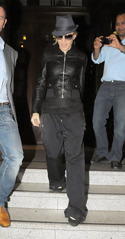 Madonna wore a charcoal fedora with her leather jacket while out filming in London.