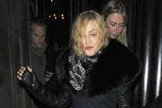 Madonna leaves the Wolseley restaurant in London after a dinner date with her French break dancer boyfriend Brahim Zaibat. They left separately - each jumping into a waiting car. The singer angered fellow flight passengers yesterday after her Virgin flight bound for London's Heathrow airport out of New York was diverted to nearby Stansted, where an overflow of weather delays kept passengers on the tarmac for three hours - except for passengers in the Madonna entourage! They were let off the plane hours before the other passengers. .