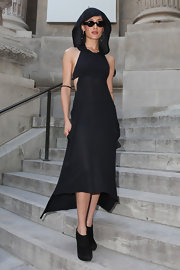 Maggie Q looked totally cool and contemporary in this hooded black dress.