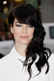Lena Headey brushed her loose waves to one side for a retro-glam vibe.