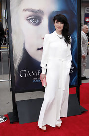Lena Headey's evening look was more on the casual side with a long-sleeved white dress.