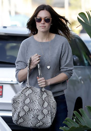 Mandy Moore spiced up her gray sweater with a snakeskin tote.
