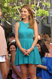 Maria stunned in a summery teal frock that featured lace detailing and a pleated skirt.