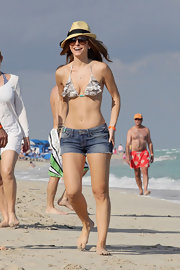 Maria Menounos rocks a bikini top as she plays on the beach with boyfriend Kevin Undergaro in Miami.