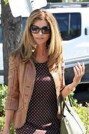 Maria Shriver kept incognito in a pair of large black oval shades.