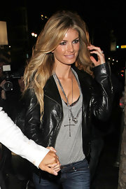 Marissa Miller paired her leather jacket and grey T-shirt with a silver cross pendant.