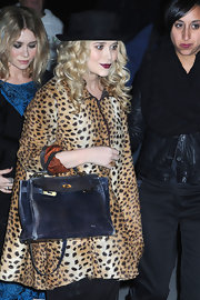 "Mary Kate is seen here carrying the essential ""Birkin "" bag in a classic black leather."