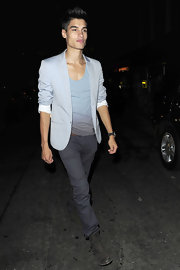 Siva Kaneswaran's laced up his sleek outfit with down and dirty boots.