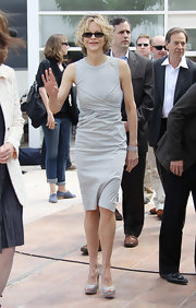 Meg showed off her classic style while out and about in Cannes in a grey day dress.