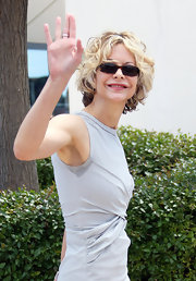 Actress Meg Ryan waved to her fans as she donned a pair of modern square glasses.