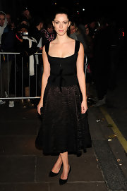 Rebecca Hall looked demure in a pair of black ladylike heels. She paired the pumps with a Louis Vuitton dress.