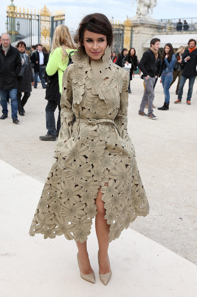 Miroslava Duma arrives at the Valentino Fall/Winter 2013/2014 fashion show, part of the Paris Womenswear Fashion Week, held at the Jardin des Tuileries in Paris.