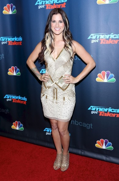 Cassadee chose a gold and cream beaded dress for her red carpet look.