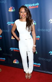 Mel B traded in her figure-hugging bodycon dress for a crisp white jumpsuit.