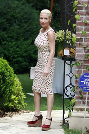 Tracy Anderson showed off her fit figure with this white and red polka dot day dress.