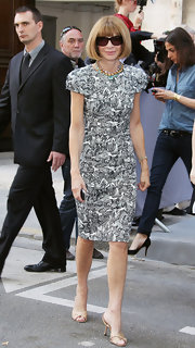 Anna's printed dress with structural shoulders was a bold choice for Vogue's Editor and Chief.