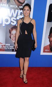 Salma showed off just a touch of skin in this sexy but classy LBD that featured silver embellishments on the neck.