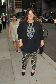 Melissa McCarthy dressed up a band tee with a cool black blazer.