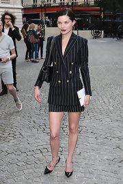 Delphine looked classically sophisticated in this black pinstripe skirt suit.