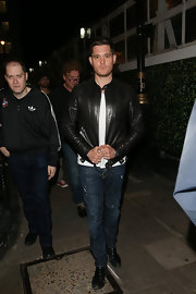 Michael Buble wore a classic leather jacket while out in London.