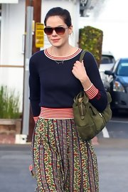 We love how Michelle mixed this classic striped sweater with a fun print skirt.
