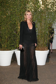 Kate Moss paired a classic blazer over her sheer dress while at the Serpentine Gallery Summer Party.