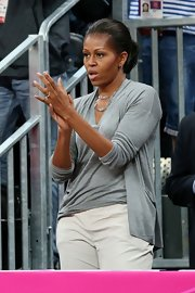 Michelle Obama looked effortlessly stylish in a gray twinset while watching a basketball game at the Olympics.