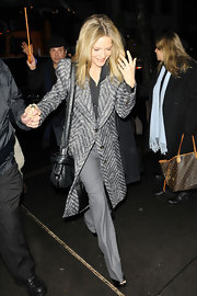 Michelle Pfeiffer dashed to the 'Today Show' in a sleek gray chevron-striped coat with bold shoulders.