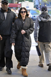 Michelle's to-the-ankle puffa might just be the coziest coat we've ever seen.