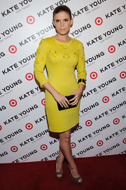 Kate Mara looked sleek and stylish as ever when she sported this fitted, canary yellow sheath dress.
