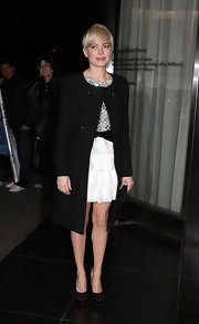 Michelle Williams paired her dazzling Azzaro cocktail dress with equally stunning black glittery platforms.