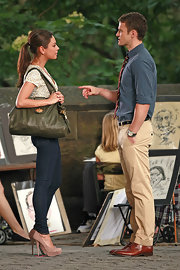 Mila Kunis carried an army green satchel while shooting scenes with Justin Timberlake for their up coming movie.