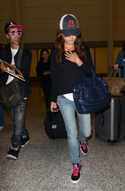 Mila Kunis dressed down in a black hoodie for a flight to Toronto.