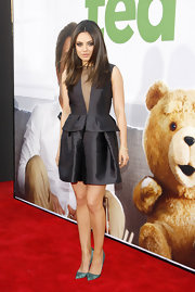 Mila Kunis looked breathtaking in her LBD with a darling peplum and sheer deep-V.