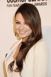 Mila Kunis rocked long tresses with a slight wave at the ends. Her deep side part added to her dramatic look.