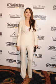 Mila pays homage to menswear in a gorgeous white pant suit at Cosmo's Fun Fearless Male Awards.