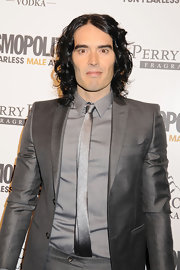 Russell opts for metallics at the Cosmo Awards in a gray iridescent tux and silver skinny tie.