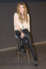 Miley Cyrus rocked an edgy pair of leather leggings with lace up ankle boots.