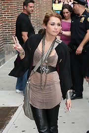 The popstar added a studded leather belt to her taupe tank top and leather pants ensemble.