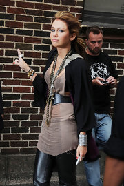Miley added an abundance of accessories to her look, including a studded silver cuff bracelet.