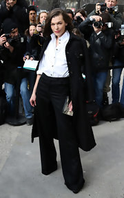 Milla Jovovich rocked wide-legged pants and a classic button down at the Chanel runway show in Paris.