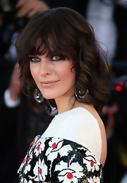 A fleshy nude lip balanced out the heaviness of Milla's bold smoky eye.
