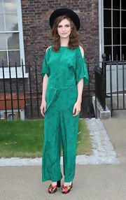 Tali Lennox chose a cold-shoulder green jumpsuit for her look at the Fashion Rules exhibit opening in London.